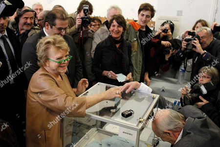 Eva Joly French Green Party candidate for the presidential elections Eva Joly, center, casts her ballot during the first round of the French elections in Paris, France, . The first round of the French presidential election will be followed by a second round on May 6, 2012