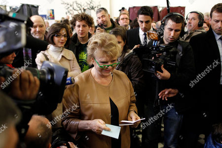 Eva Joly French Green Party candidate for the 2012 presidential election Eva Joly, center, shows her ballot before voting during the first round of the presidential elections in Paris, France, . The first round of the French presidential election will be followed by a second round on May 6, 2012