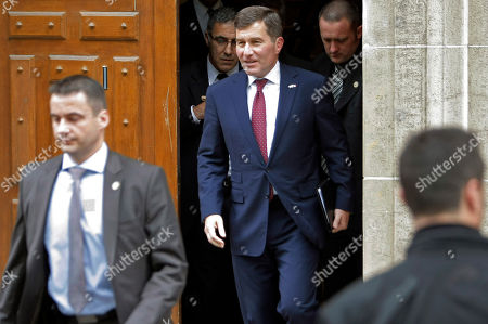 Charles H. Rivkin, the US ambassador to France, center, leaves the Socialist Party headquarters after meeting with President-elect Francois Hollande in Paris . France has awoken to a new era after electing Socialist Hollande as president, a leftist pledging to buck Europe's austerity trend and NATO's timetable for Afghanistan