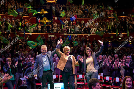 Environmentalist candidate for the French presidential election Eva Joly, center, leader of the Greens in the EU parliament, Daniel Cohn-Bendit, left, and Europe Ecologie-Les Verts Green party head Cecile Duflot, right, wave during a campaign rally, in Paris