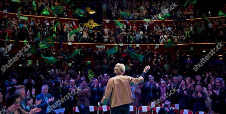 Environmentalist candidate for the French presidential election Eva Joly, center, waves prior to deliver a speech during a campaign rally, in Paris