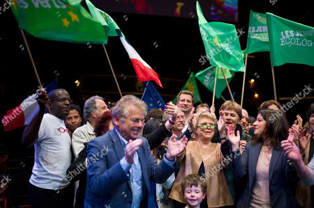 Environmentalist candidate for the French presidential election Eva Joly, foreground center, Europe Ecologie-Les Verts Green party head Cecile Duflot, foreground right, and leader of the Greens in the EU parliament, Daniel Cohn-Bendit, foreground left, applause at the end of a campaign rally, in Paris