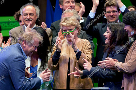 Environmentalist candidate for the French presidential election Eva Joly, center, and Europe Ecologie-Les Verts Green party head Cecile Duflot, right, applause as leader of the Greens in the EU parliament, Daniel Cohn-Bendit, left, dances at the end of a campaign rally, in Paris