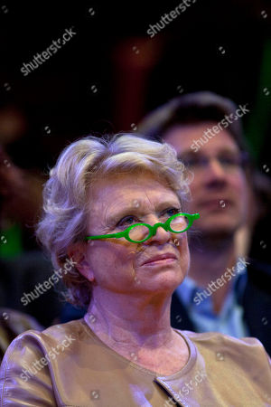 Environmentalist candidate for the French presidential election Eva Joly listens a speech during a campaign rally, in Paris