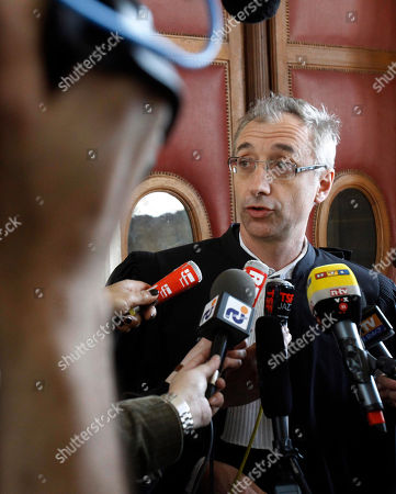 Jean-Paul Guerlain's lawyer Basile Ader addresses reporters at a Paris Court House, in Paris, after a French court convicted longtime perfume maker Jean-Paul Guerlain of making racist insults on national television and fined him Thursday Euros 6,000 ($8,000). The 75-year-old Guerlain, an heir to his family's cosmetics empire, provoked anger among French minorities with the comments in a 2010 interview on France-2 television. Lawyers for the SOS Racism association said Guerlain abused the national platform he was given