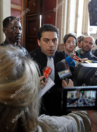SOS Racism lawyer Patrick Klugman addresses reporters at Paris Court House, after French court convicted longtime perfume maker Jean-Paul Guerlain of making racist insults on national television and fined him Thursday Euros 6,000 ($8,000). The 75-year-old Guerlain, an heir to his family's cosmetics empire, provoked anger among French minorities with the comments in a 2010 interview on France-2 television. Lawyers for the SOS Racism association said Guerlain abused the national platform he was given