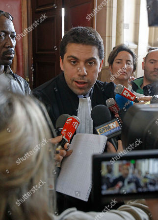SOS Racism lawyer Patrick Klugman addresses reporters at a Paris Court House, after French court convicted longtime perfume maker Jean-Paul Guerlain of making racist insults on national television and fined him Thursday Euros 6,000 ($8,000). The 75-year-old Guerlain, an heir to his family's cosmetics empire, provoked anger among French minorities with the comments in a 2010 interview on France-2 television. Lawyers for the SOS Racism association said Guerlain abused the national platform he was given