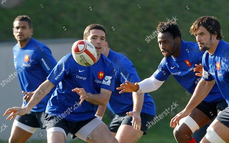 French rugby team players from left, Wesley Fofana, Dimitri Yachvili, Fulgence Ouedraogo, and Julien Pierre practice during a training session at the National Rugby Center in Marcoussis, south of Paris, . France are preparing for their upcoming Six Nations tournament match against Wales on Saturday