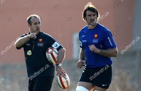 Stock Image of French rugby team head coach Philippe Saint-Andre, left, speaks with Julien Pierre during a training session at the National Rugby Center in Marcoussis, south of Paris, . France are preparing for their upcoming Six Nations tournament match against Wales on Saturday