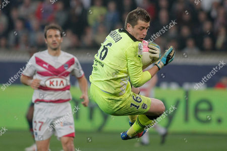 Bordeaux's goalkeeper Cedric Carrasso, blocks the ball during his French League One soccer match against Paris Saint Germain, at the Parc des Princes stadium, in Paris