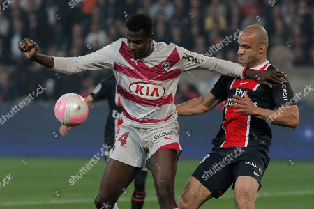 Stock Picture of Paris Saint Germain's Defender Alex Rodrigo Dias Da Costa from Brazil, right, challenges for the ball with Bordeaux's forward Cheick Diabate, left, during their French League One soccer match, at the Parc des Princes stadium, in Paris