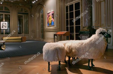 Photography, left, created by U.S Photogrpher Richard Avedon, Brigitte Bardot, Hair by Alexandre, Paris Studio, 1959 with the painting, center, titled Gunter Sachs created by Andy Warhol, 1972, and Sheep (Muttons), right, created by Francois-Xavier Lalanne, 1968, is seen during a Sotheby's exhibition preview in Paris, . The auction will be held at Sotheby's in London on May 22-23