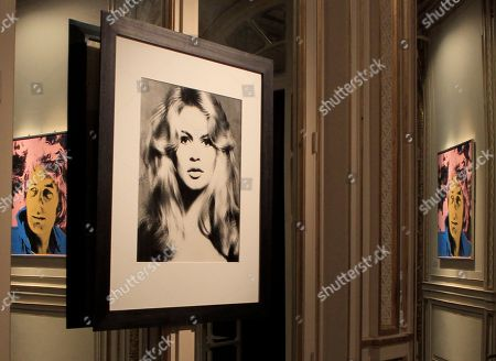Photography, center, created by U.S Photographer Richard Avedon, Brigitte Bardot, Hair by Alexandre, Paris Studio, 1959 with The painting, left and right, titled Gunter Sachs created by Andy Warhol, 1972, is seen during a Sotheby's exhibition preview in Paris, . The auction will be held at Sotheby's in London on May 22-23