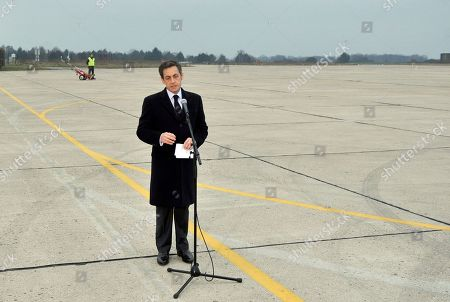 French President Nicolas Sarkozy gives a speech on the tarmac of the Villacoublay military airport after the plane carrying French reporter, Edith Bouvier, and French photographer, William Daniels, landed outside Paris, . Two French journalists who were smuggled out of Syria have arrived in France. Edith Bouvier, who was injured, and William Daniels were caught up in a Syrian government siege of a rebel-held neighborhood in the city of Homs