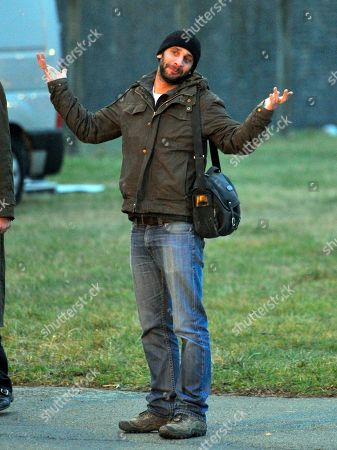 French photographer, William Daniels, reacts as he prepares to leave the Villacoublay military airport, outside Paris, after the plane carrying him and French journalist Edith Bouvier landed, . Two French journalists who were smuggled out of Syria have arrived in France. Edith Bouvier, who was injured, and William Daniels were caught up in a Syrian government siege of a rebel-held neighborhood in the city of Homs