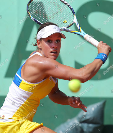Canada's Stephanie Dubois returns against Shahar Peer of Israel in the first round match at the French Open tennis tournament in Roland Garros stadium in Paris