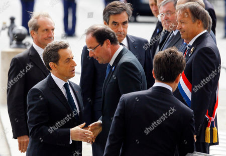 Francois Hollande, Nicolas Sarkozy Outgoing French President Nicolas Sarkozy, second left, shakes hands with President-elect Francois Hollande during commemorations at the Arc de Triomphe, in Paris, marking the anniversary of the end of World War II in Europe. French Defense Minister Gerard Longuet, at left, Prime Minister Francois Fillon, rear center, and President of the Senate Assembly, Jean Pierre Bel, at right