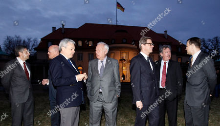 The Foreign Ministers from Austria, Michael Spindelegger, the Netherlands, Uri Rosenthal, Belgium, Didier Reynders, Spain, Jose Manuel Garcia-Margallo, Germany, Guido Westerwelle, Luxembourg, Jean Asselborn and Poland, Radoslaw Sikorski, from left, walk in front of the Villa Borsig, the guesthouse of the German Ministry, during a meeting in Berlin, Germany