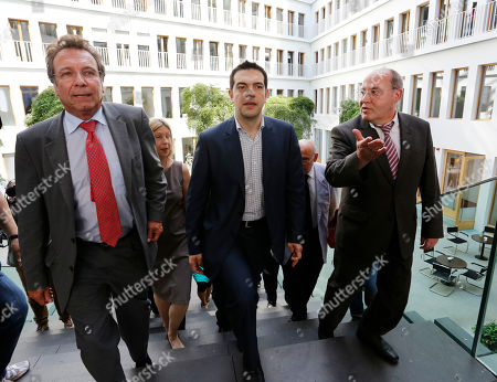 Klaus Ernst, Alexis Tsipras, Gregor Gysi Alexis Tsipras, center, the leader of Greece's anti-austerity Syriza coalition, arrives for a press conference with leaders of Germany's Left Party Klaus Ernst, left, and Gregor Gysi in Berlin, Germany