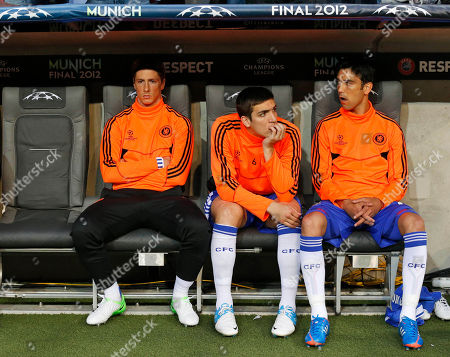 Chelsea's Fernando Torres, left, Paulo Ferreira, center, and Oriol Romeu sit on the bench during the Champions League final soccer match between Bayern Munich and Chelsea in Munich, Germany