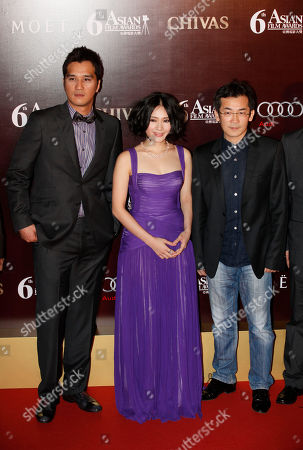 Wei Te-sheng, Lo Mei-ling, Jimmy Huang From right, Taiwan's director Wei Te-sheng, actress Lo Mei-ling and actor Jimmy Huang pose on the red carpet of the Asian Film Awards in Hong Kong