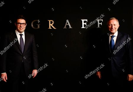 """Founder and Chairman of Graff Diamonds Laurence Graff, right, and CEO Francois Graff, left, pose before attending the IPO roadshow in Hong Kong . British jeweler Graff Diamonds posted a so-called """"red herring"""" prospectus on the Hong Kong stock exchange website over the weekend as it prepares to hold an initial public offering, becoming the latest foreign luxury brand company to targeting growth in China"""