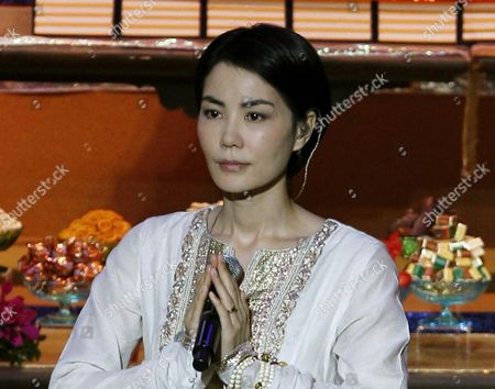 Faye Wong, Wang Fei Chinese pop singer Faye Wong, also known as Wang Fei, performs during the opening ceremony of the third World Buddhist Forum in Hong Kong. China's state media have criticized celebrities for attending an event on Feb. 14, 2016 in northern India with members of the Tibetan government-in-exile, adding to Chinese authorities' warnings about how actors and singers must behave