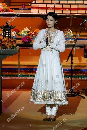 Faye Wong Chinese pop singer Faye Wong performs during the opening ceremony of the third World Buddhist Forum in Hong Kong