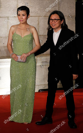 Peter Chan, Sandra Ng Hong Kong director Peter Chan, right and his wife Hong Kong actress Sandra Ng pose on the red carpet of the 31st Hong Kong Film Awards in Hong Kong