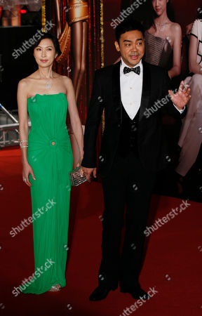 Sean Lau, Amy Hong Kong actor Sean Lau, right and his wife Amy pose on the red carpet of the 31st Hong Kong Film Awards in Hong Kong