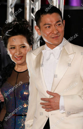Andy Lau, Deanie Ip Hong Kong actor Andy Lau, right and actress Deanie Ip pose on the red carpet of the 31st Hong Kong Film Awards in Hong Kong