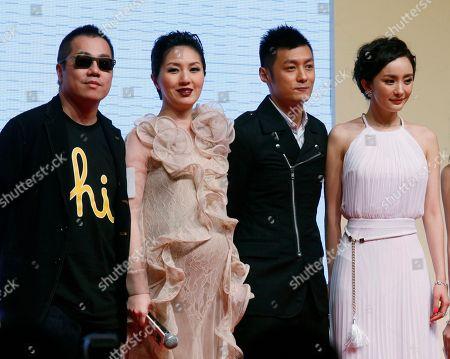 """Pang Ho-cheung, Miriam Yeung, Shawn Yue, Mini Yang From left, Hong Kong director Pang Ho-cheung, actress Miriam Yeung, actor Shawn Yue and Chinese actress Mini Yang pose at the movie premiere of """"Love in the Buff"""" in Hong Kong"""