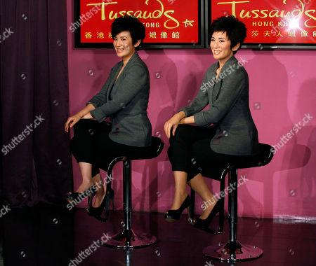 Sandra Ng Award winning Hong Kong actress Sandra Ng, left, poses with her wax figure during its unveiling ceremony at Madame Tussauds in Hong Kong