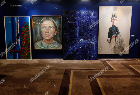 "Two paintings titled ""Portrait"", second from left, and ""Trauma"", right, by Chinese artist Zeng Fanzhi are displayed for sale at the Seoul Auction in Hong Kong . Auctioneers in Hong Kong have sold 10 paintings seized from a South Korean bank that collapsed last year amid a corruption scandal to raise $2.4 million to help repay depositors. The paintings included works by noted Chinese artists Zeng and Zhang Xiaogang and American Julian Schnabel"