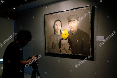 "A painting titled ""Bloodline - Big Family: Family No.2"" created by Chinese artist Zhang Xiaogang is displayed at a media preview for the Sotheby's Auction Contemporary Asian Art Spring Sale 2012 in Hong Kong, . The painting is expected to sell for HK$25-35 million (US$3.2- 4.5 million) and will be on sale on April 2, 2012"