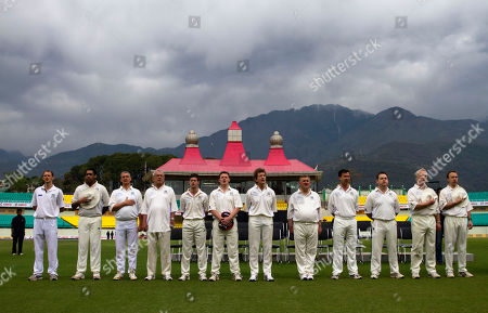 British parliamentarians stand for their national anthem at the HPCA Cricket Stadium before a friendly cricket match against Indian parliamentarians in Dharmsala, India, . From right to left are Matthew Hancock, Graham Stuart, Nigel Adams, Mark Lancaster, Oliver Colvile, Lord Faulks, Nicholas King, Alexander Jackman, Lord Razzall, Graham Jones, Shiv Haria-Shah and Paul Rennie