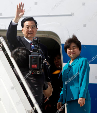 Stock Picture of Hu Jintao, Liu Yongqing Chinese President Hu Jintao, left, waves, as his wife Liu Yongqing, right, looks, as they board their aircraft at the Palam technical airport in New Delhi, India, . The Chinese leader left India Friday after attending the BRICS Summit