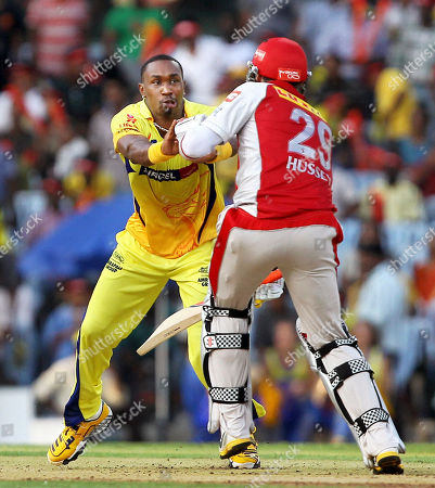 David Hussey, Dwayne Bravo Kings XI Punjab's David Hussey collides with Chennai Super Kings' Dwayne Bravo while running between the wickets during the Indian Premier League (IPL) cricket match, in Chennai, India