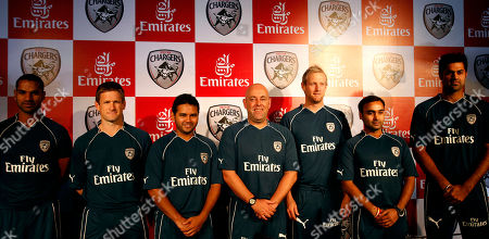 Shikhar Dhawan, Daniel Harris, Parthiv Patel, Coach Darren Lehman, Cameron White, Amit Mishra, Manpreet Gony Deccan Chargers cricketers, from left, Shikhar Dhawan, Daniel Harris, Parthiv Patel, Coach Darren Lehman, Cameron White, Amit Mishra and Manpreet Gony pose for photos during a press conference in Hyderabad, India, . International airline Emirates will be the team sponsor of Deccan Chargers for three Indian Premier League (IPL) seasons, according to news reports