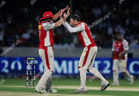 David Hussey, Azhar Mahmood Kings XI Punjab bowler David Hussey, right, with Azhar Mahmood, celebrates the wicket of Deccan Chargers Daniel Harris during their Indian Premier League (IPL) cricket match in Hyderabad, India