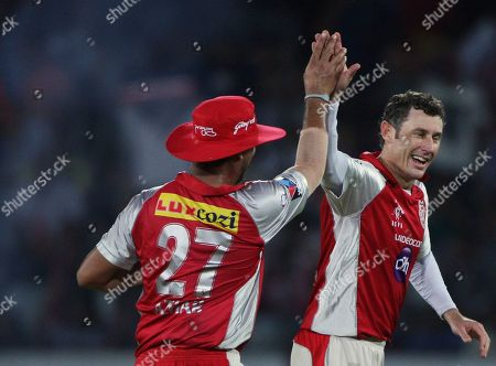 David Hussey, Azhar Mahmood Kings XI Punjab bowler David Hussey, right, with Azhar Mahmood, celebrates the wicket of Deccan Chargers Cameron White during their Indian Premier League (IPL) cricket match in Hyderabad, India