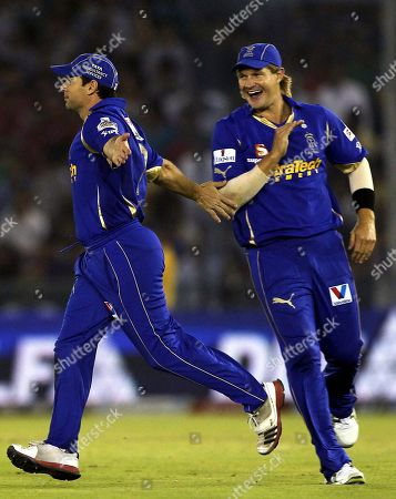 Rajasthan Royals' Brad Hodge and Shane Watson, right, celebrate the dismissal of Kings XI Punjab's David Hussey during their Indian Premier League cricket match in Mohali, India