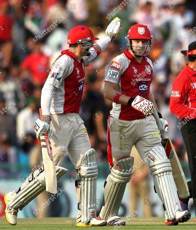 David Hussey, David Miller Kings XI Punjab batsmen David Hussey, left and David Miller celebrate after their innings against Mumbai Indians during their Indian Premier League (IPL) match in Mohali, India
