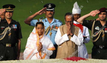 Pratibha Patil, Devi Singh Patil Indian President Pratibha Patil, second left, with her husband Devi Singh Patil pay tributes to country's first Prime Minister Jawaharlal Nehru on his 48th death anniversary at his memorial in New Delhi, India