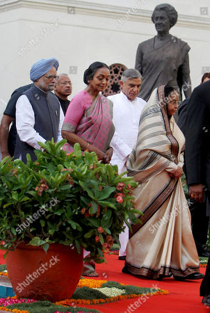 Pratibha Patil, Manmohan Singh, Meira Kumar Indian President Pratibha Patil, right, Indian Prime Minister Manmohan Singh, left, and Speaker of lower house Meira Kumar, third right, arrive to attend a special session held to mark sixty years of the Indian parliament in New Delhi, India, . A statue of former Prime Minister Indira Gandhi is seen behind