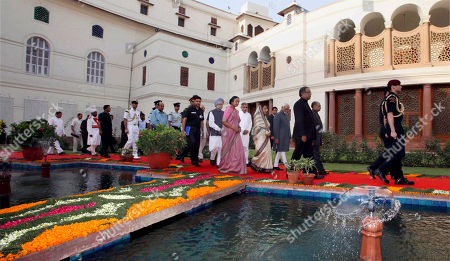 Pratibha Patil, Manmohan Singh, Meira Kumar Indian President Pratibha Patil, center right in an ivory saree, Indian Prime Minister Manmohan Singh, center left in a blue turban, and Speaker of lower house Meira Kumar, center in a pink saree, arrive to attend a special session held to mark sixty years of the Indian parliament in New Delhi, India