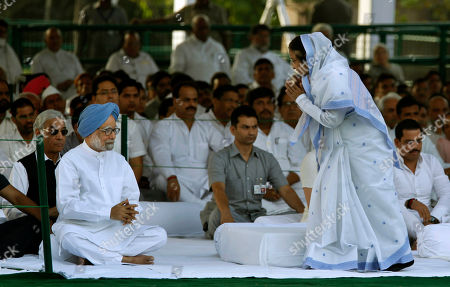 Pratibha Patil, Manmohan Singh Indian President Pratibha Patil, right, greets Indian Prime Minister Manmohan Singh, left, and others at the memorial of former Indian Prime Minister Rajiv Gandhi on occasion of his death anniversary in New Delhi, India, . Rajiv Gandhi was killed in a suicide bomb attack on May 21, 1991 in Tamil Nadu while campaigning during national elections