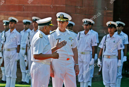 Stock Picture of Jonathan Greenert, Nirmal Verma Adm. Jonathan Greenert, chief of the United States' Naval Operations, right, talks to Indian Navy Chief, Adm. Nirmal Verma after inspecting a guard of honor outside the Defense Ministry in New Delhi, India