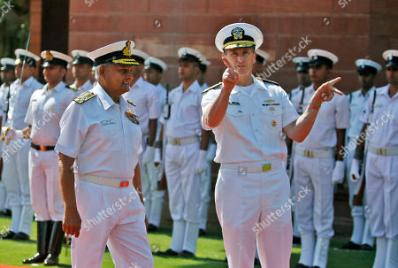 Jonathan Greenert, Nirmal Verma Adm. Jonathan Greenert, chief of the United States' Naval Operations, right, talks to Indian Navy Chief, Adm. Nirmal Verma after inspecting the guard of honor outside the Defense Ministry in New Delhi, India