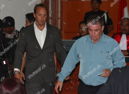 Australian survivors of 2002 Bali bombings Stuart Anstee, left, and Peter Hughes, right, enter the court room to testify against Indonesian militant Umar Patek in his trial at West Jakarta district court in Jakarta, Indonesia, . Patek is accused of building the massive bomb used in the deadly attacks on the resort island